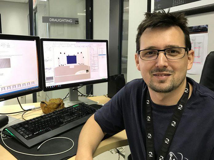 Kevin Rieck, Head of Drafting at MGG poses by his computer screen