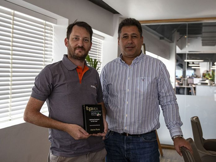 Protec Aaron Russ and Robe Elie Battah pose together with TPMEA Award