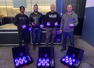 Gearhouse South Africa staff holding Astera lighting fixtures