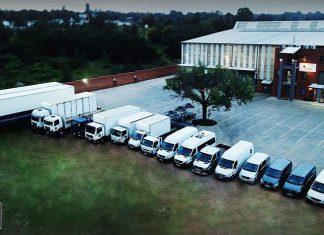 MGG vehicles outside warehouse